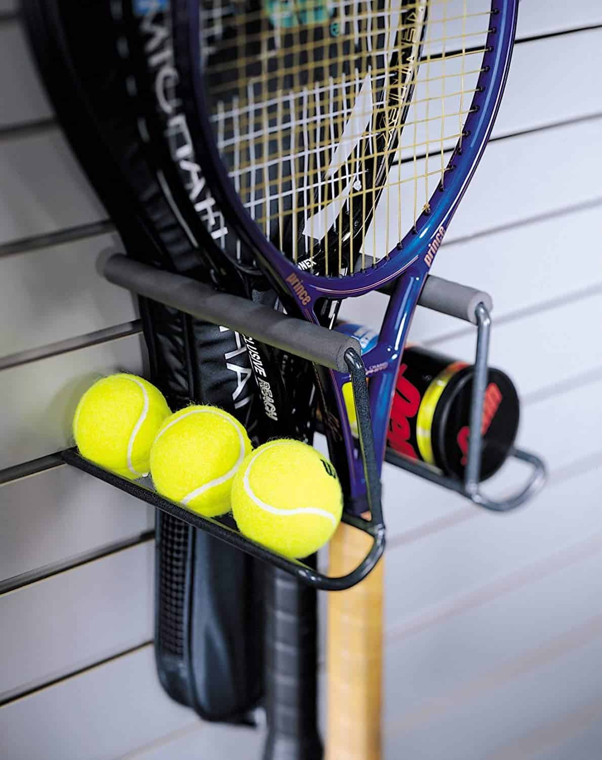 Tennis Racquet storage ideas. A hook to hold both the raquets and the balls.